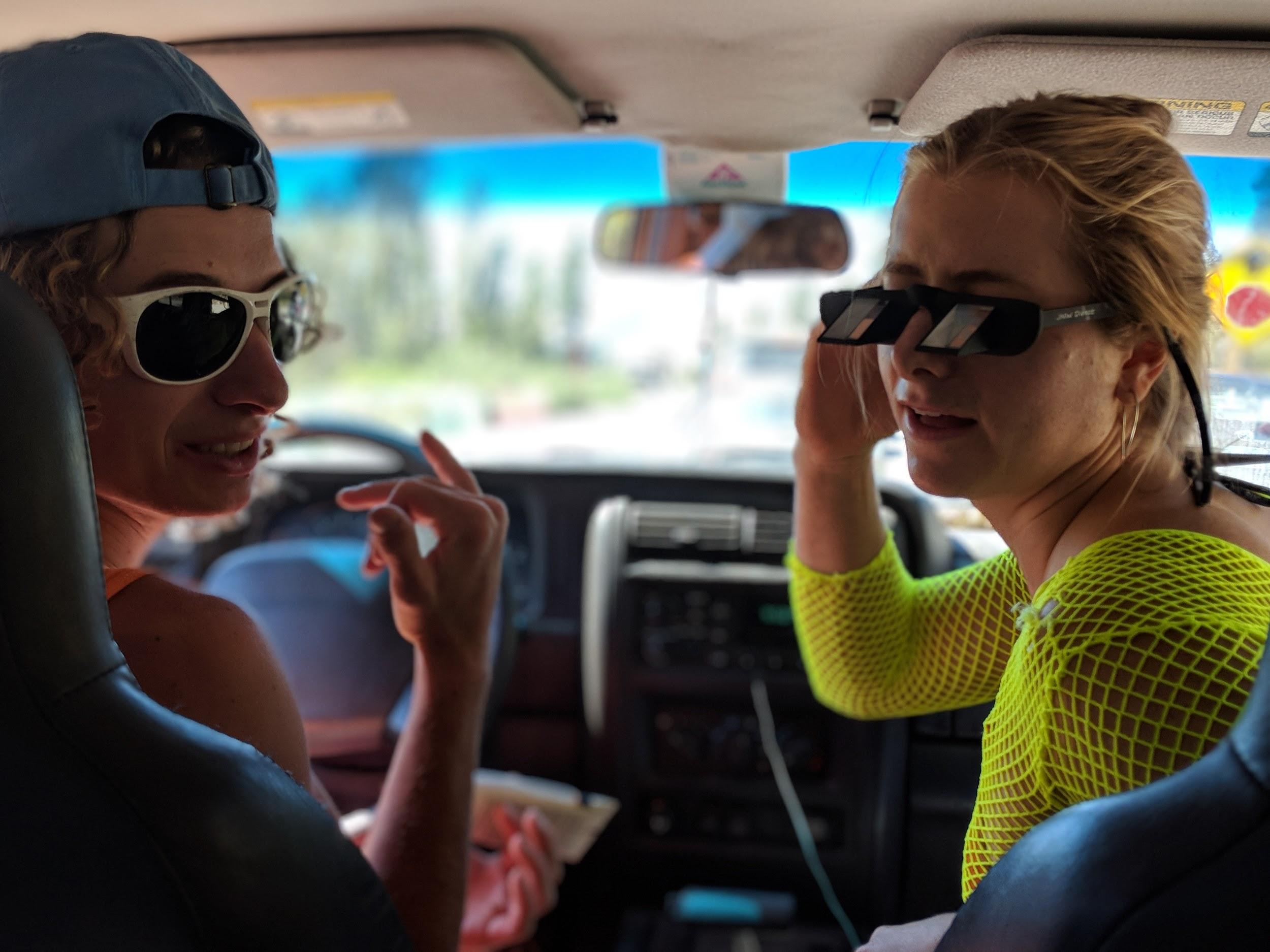 Climbers Wearing Glacier Glasses And Belay Glasses In A Car
