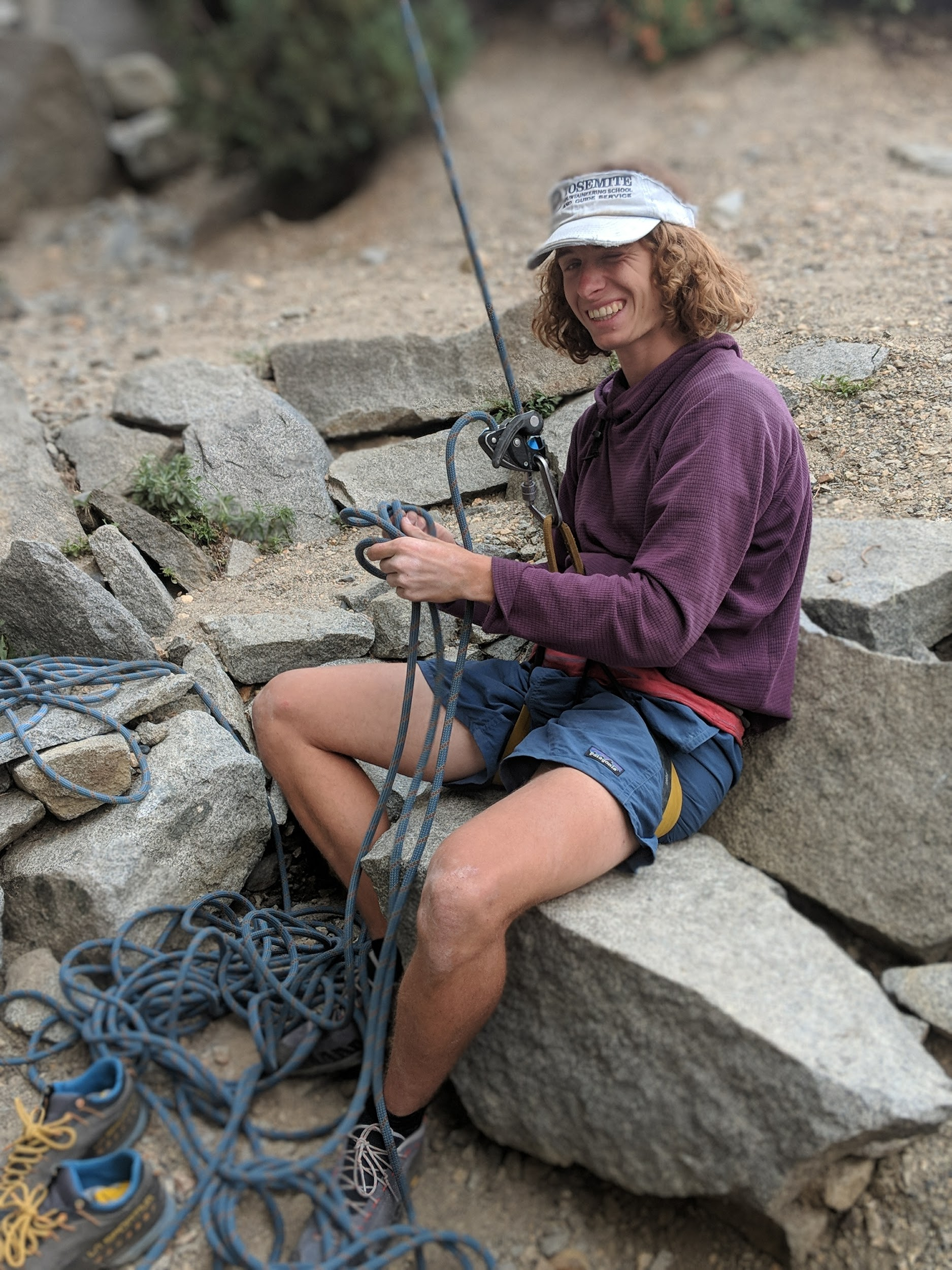 A Male Rock Climbing Belaying Using A Grigri