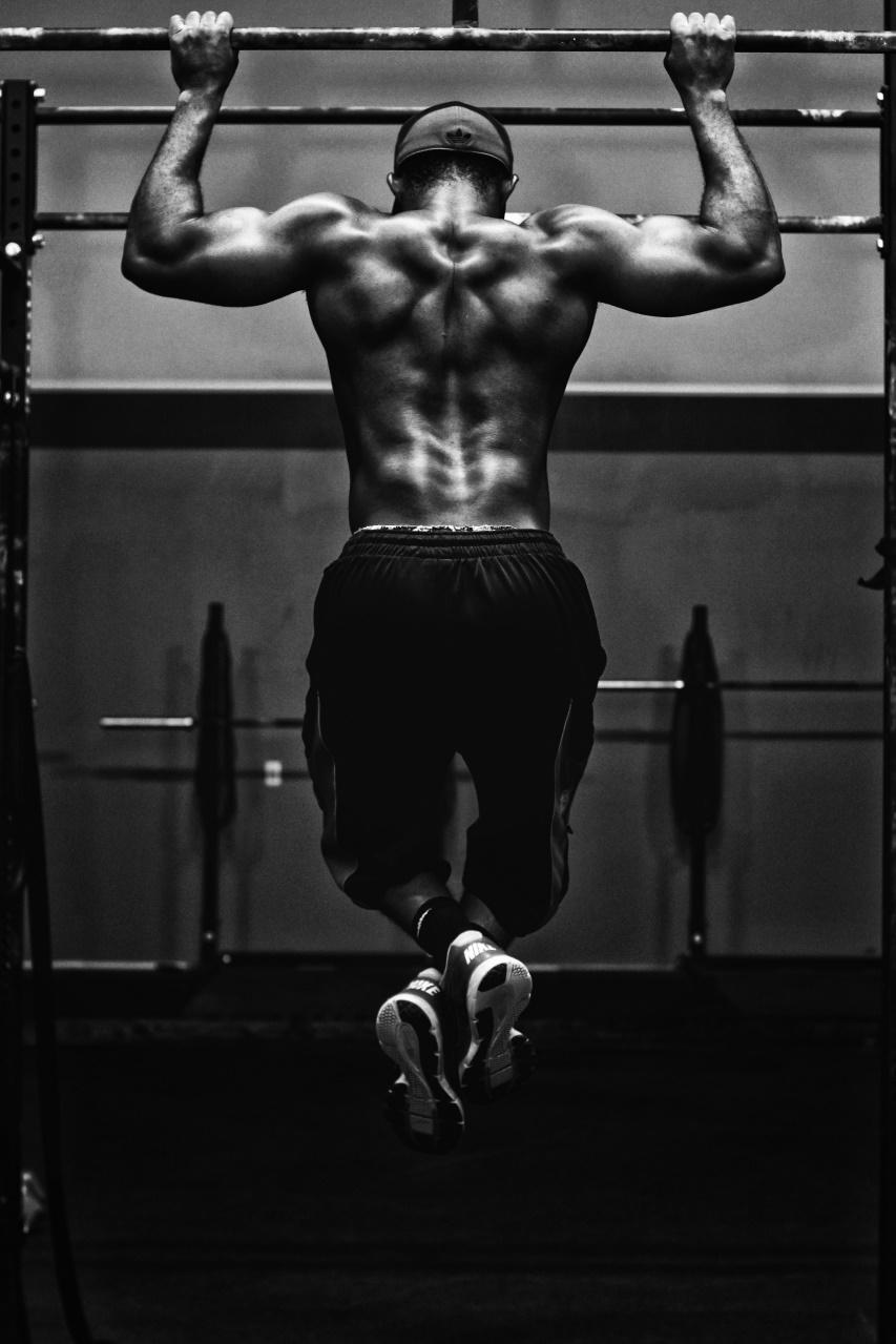 Muscular Man Performing Chinups