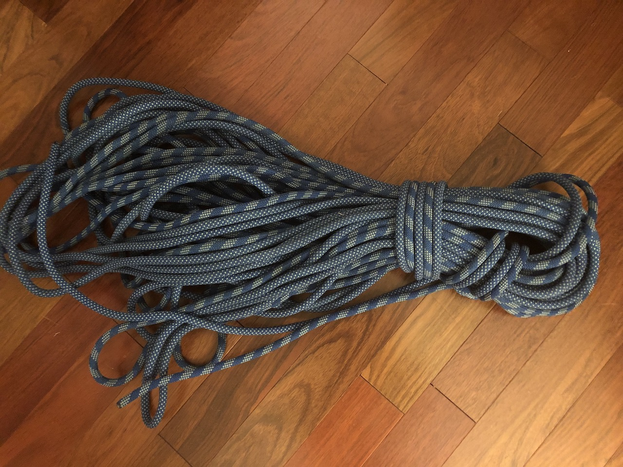 Climbing Rope Coiled Up On A Wooden Floor