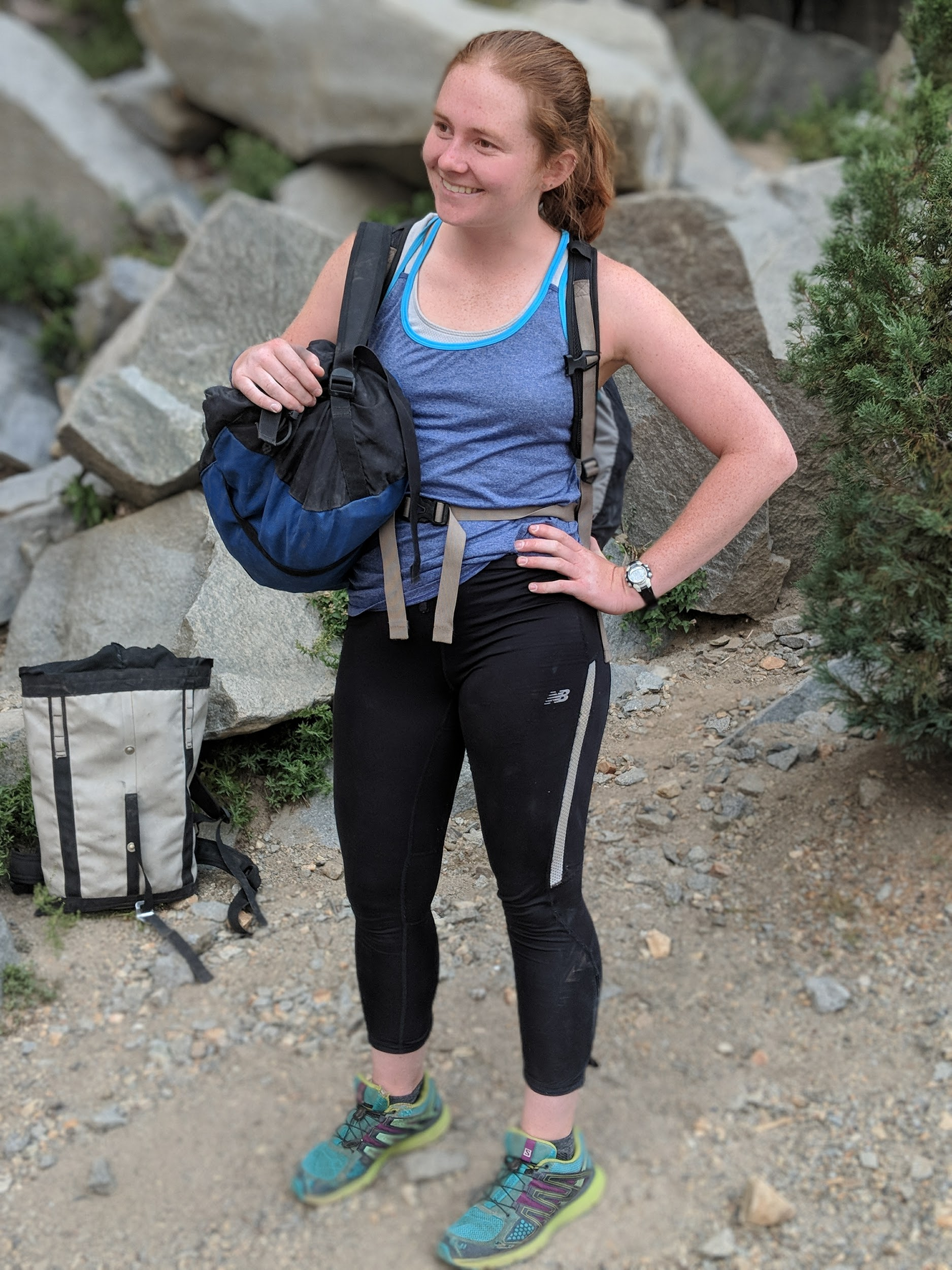 Female Rock Climber Wearing Spandex Leggings And A Synthetic Tank Top