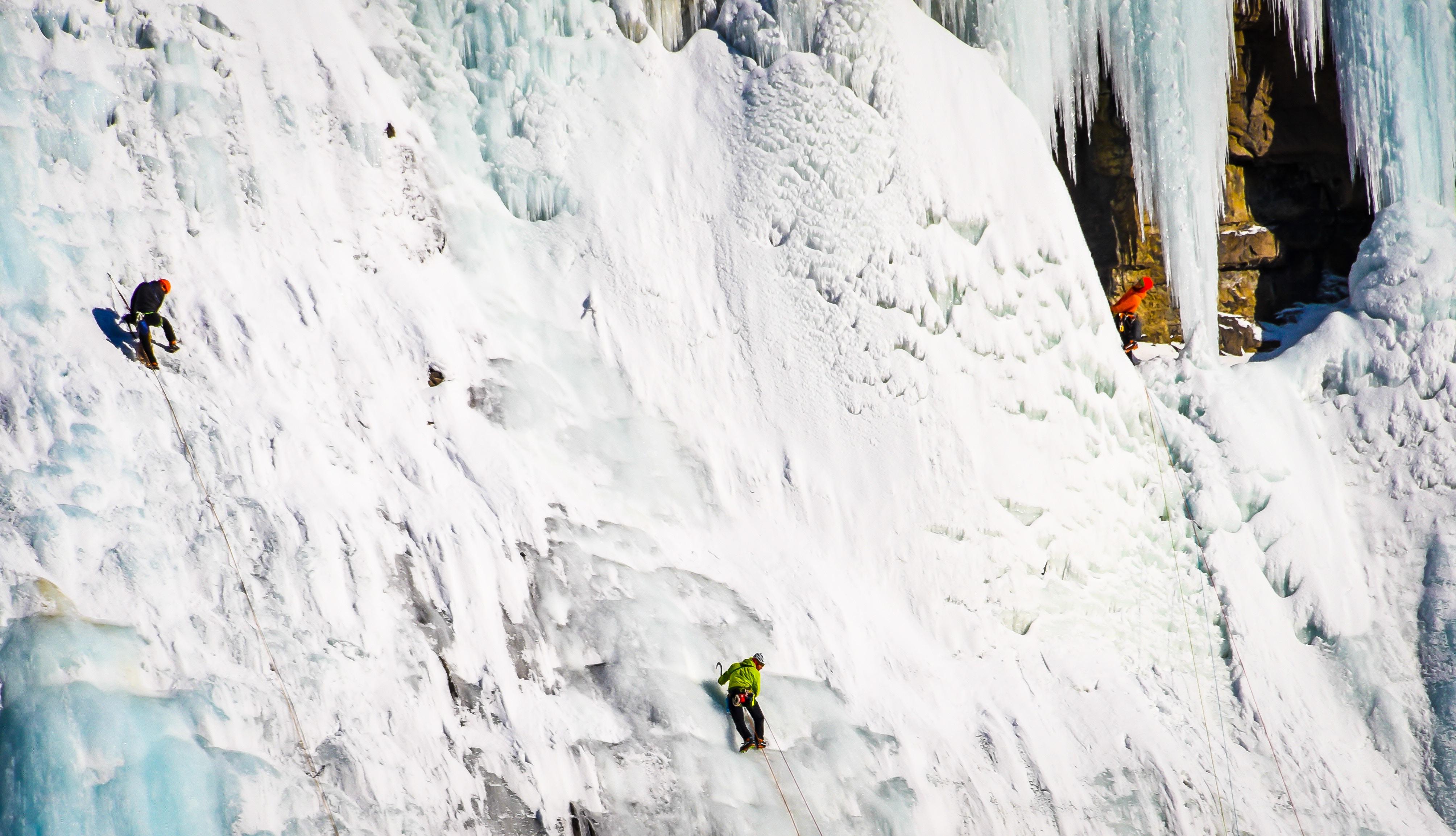 Three Climbers Ice Climbing