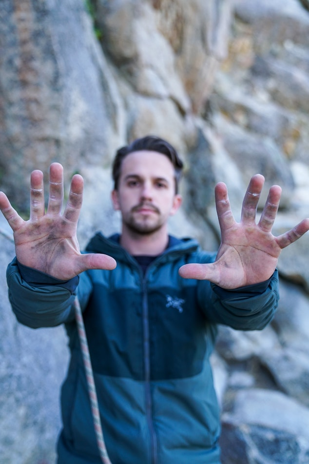 Male Climber Showing Dirt On Hands From Dirty Climbing Rope