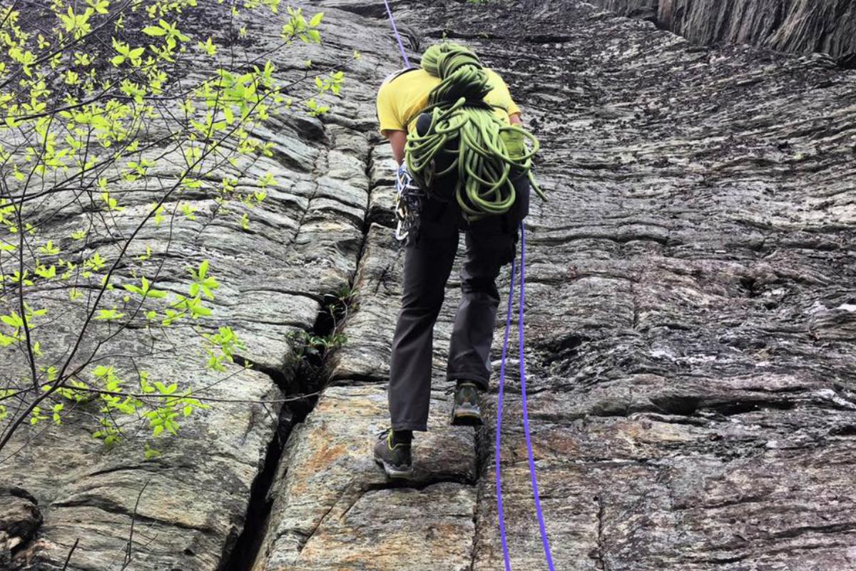 Rock Climber Abseiling Off A Climb