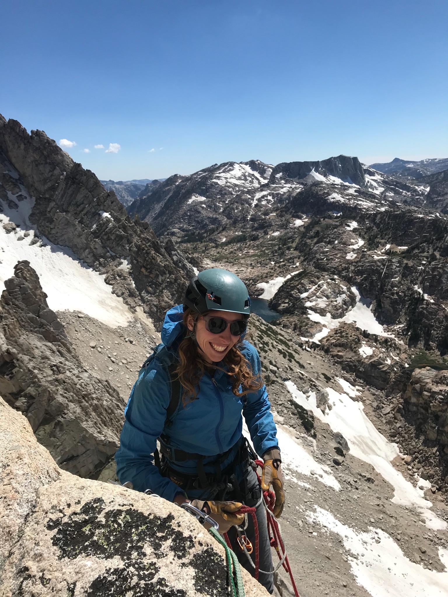 Alison Kaplan Rock Climbing Wearing Glacier Glasses