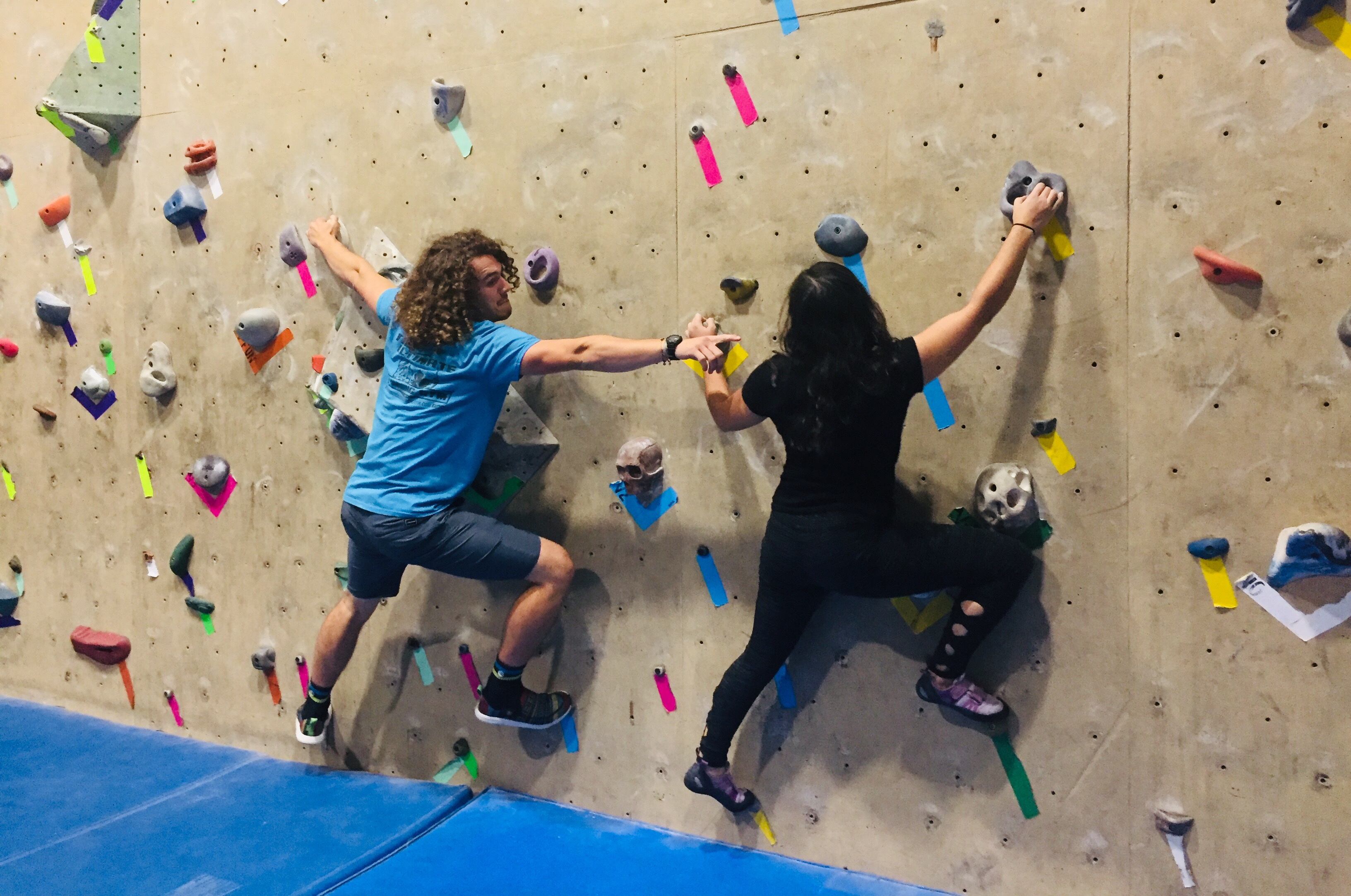 Two Climbers Playing Bouldering Tag