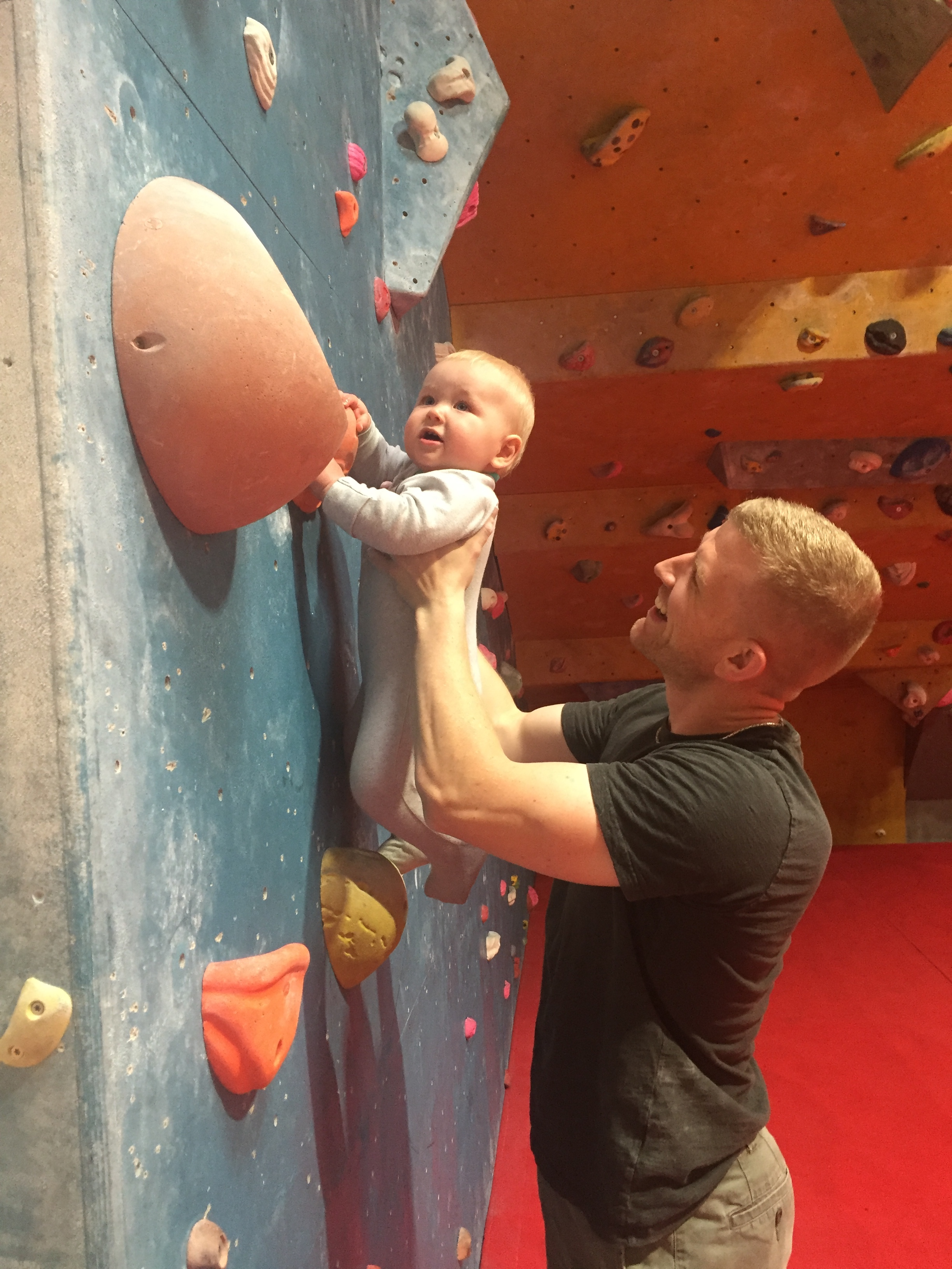 Male Climber Climbing With Baby
