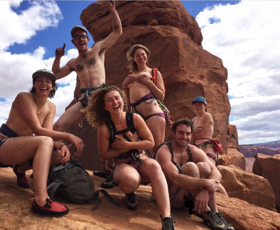 A Group Of Naked Rock Climbers