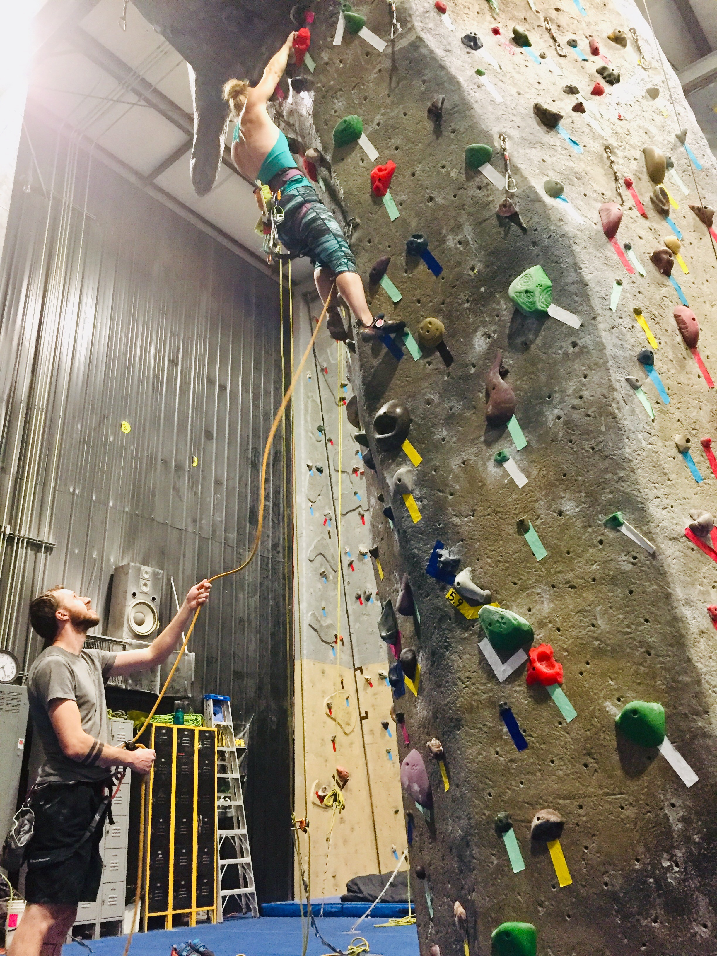 Female Climber Playing The Forced Fall Climbing Game
