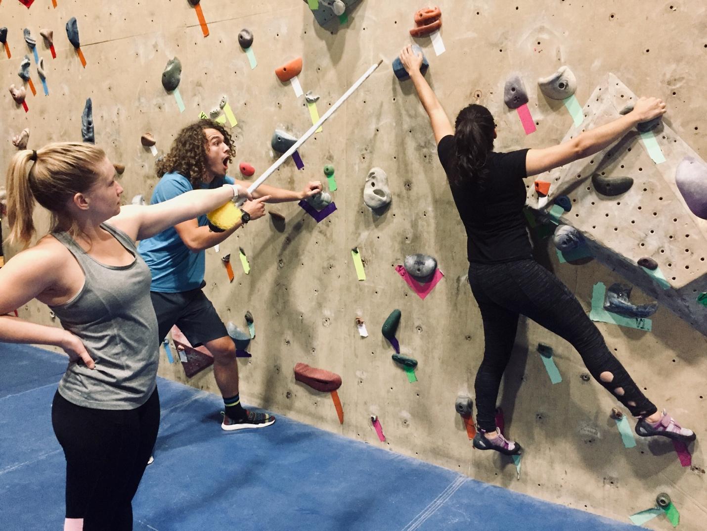 Three Climbers Playing Stick On Climbing Game