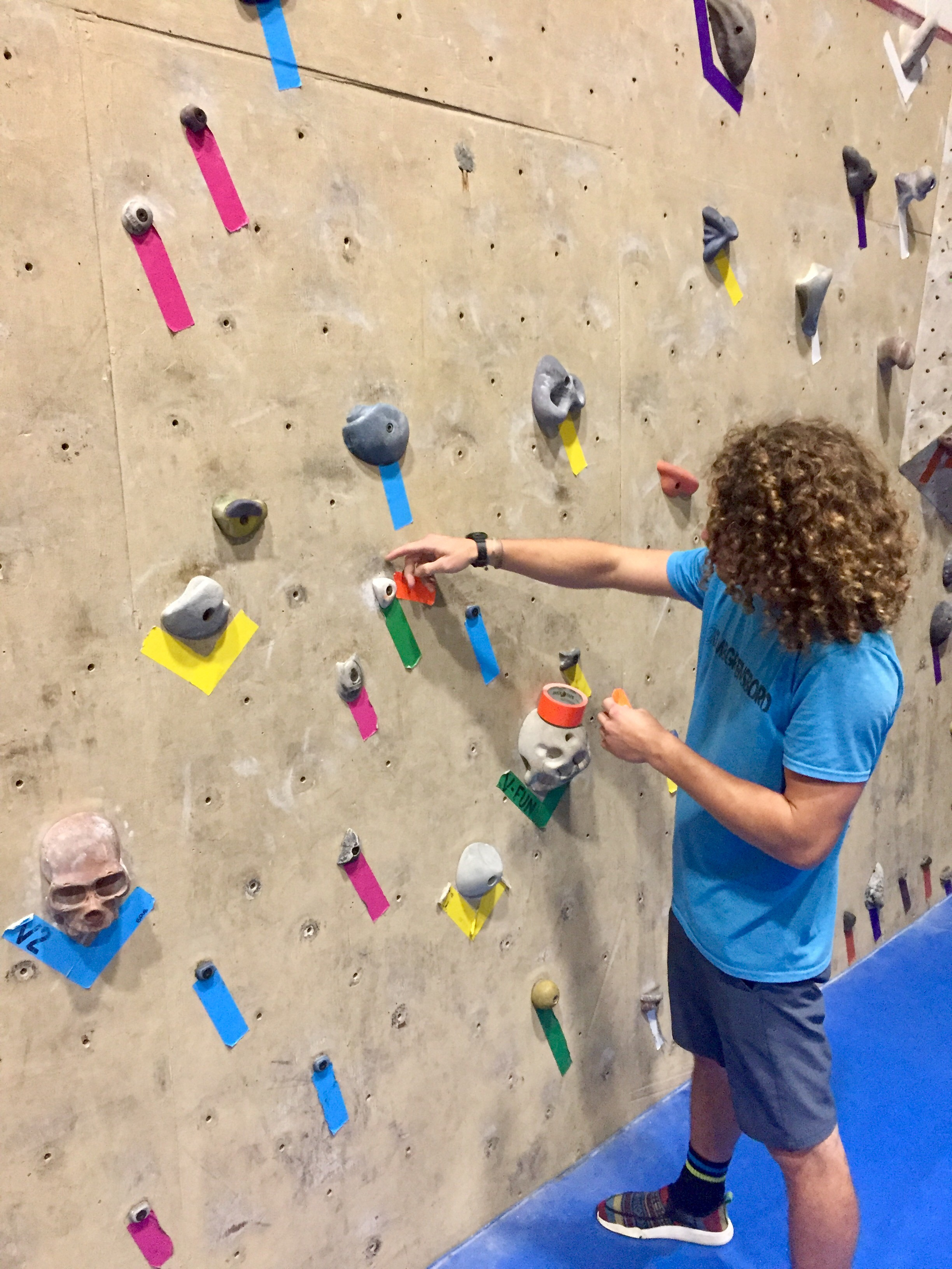 Male Climber Setting Up The Climbing Game Twister