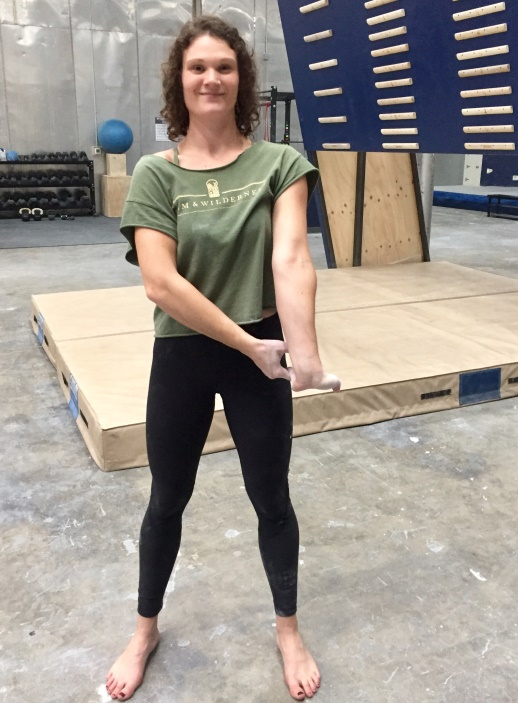 Female Climber Doing Forearm Extensor Stretches