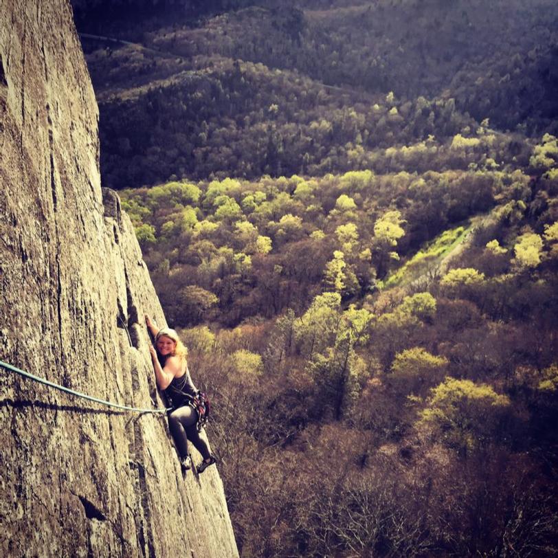 Woman Climbing Steep Slab Traverse
