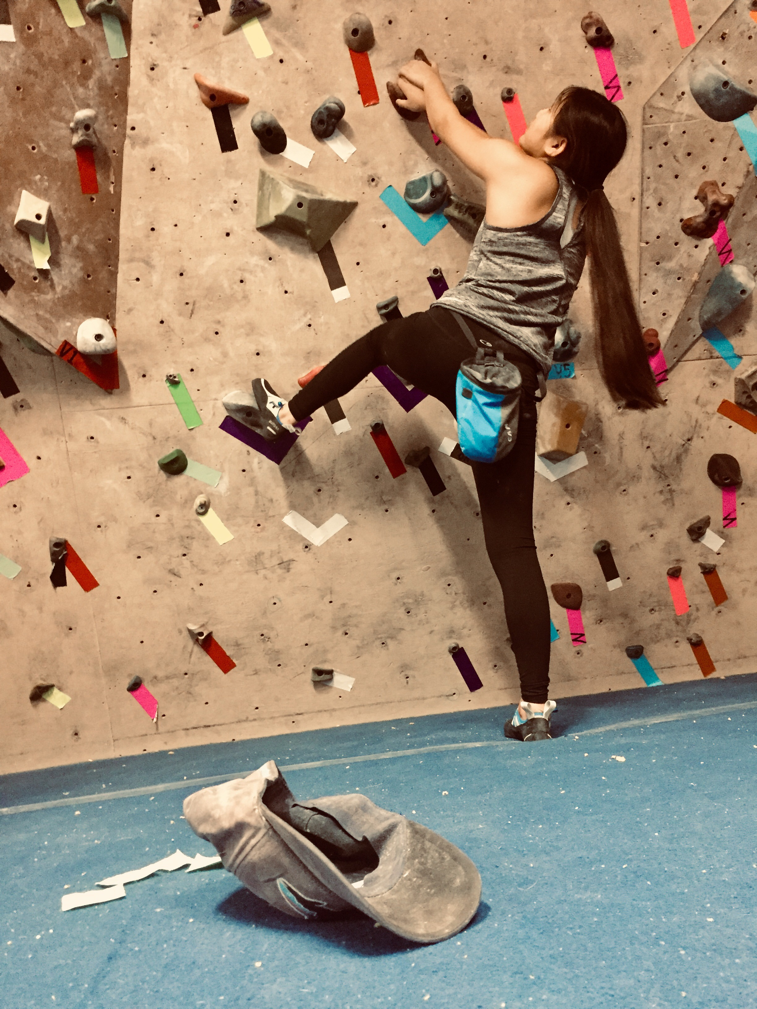 Female Climber Starting An Indoor Bouldering Route