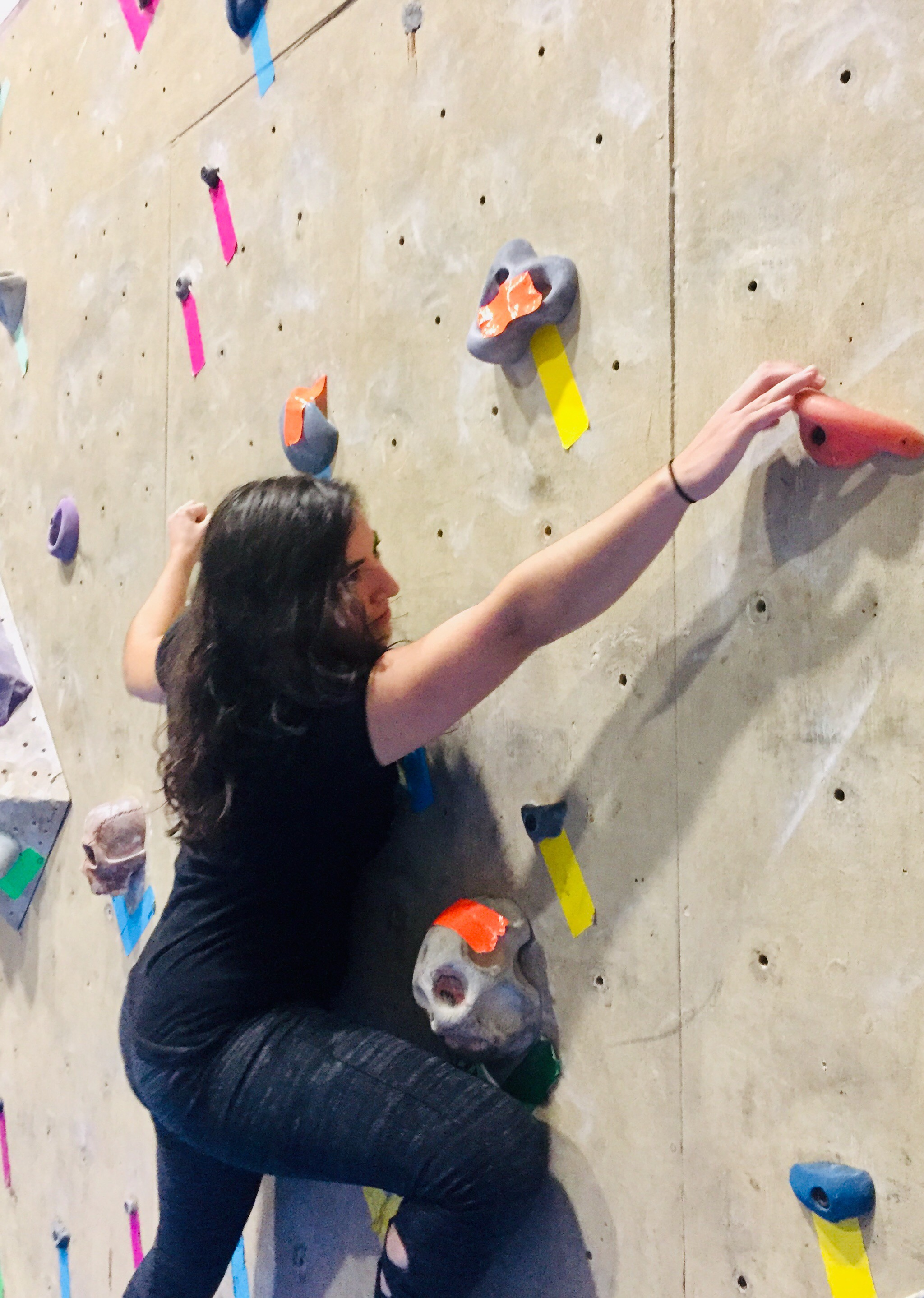 Female Climber Playing The Eliminator Climbing Game