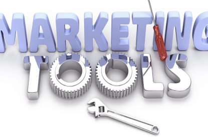 """A sign saying """"marketing tools"""" and the word tools looks like different tools you would see in a tool kit."""