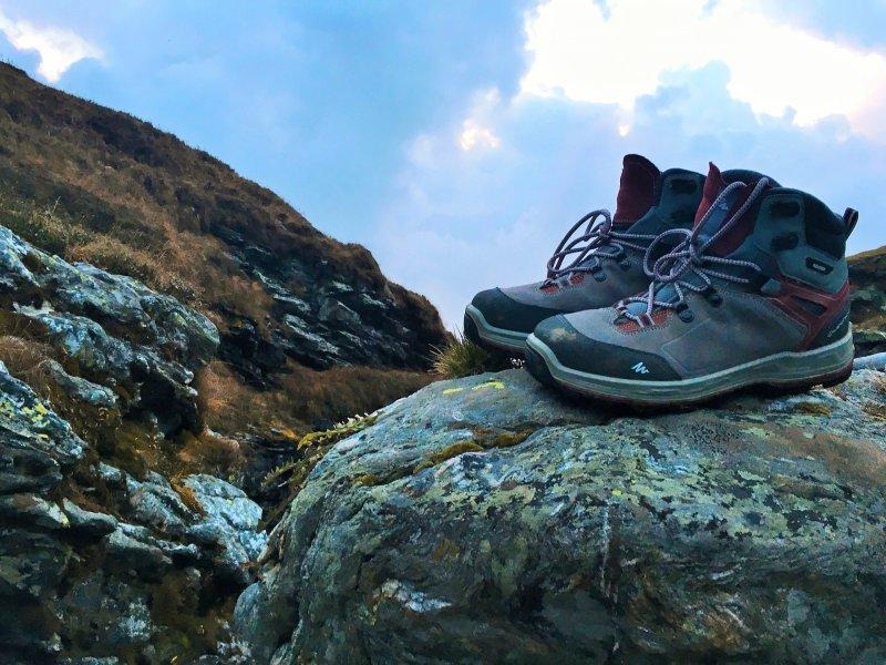 Trekking boots on a rock