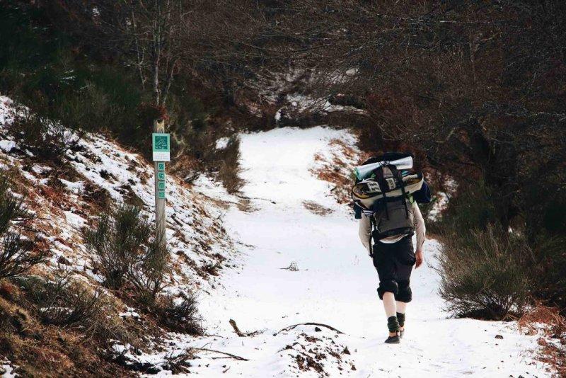 Man trekking in snow