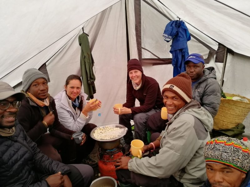 Follow alice mess tent with climbers and crew eating popcorn