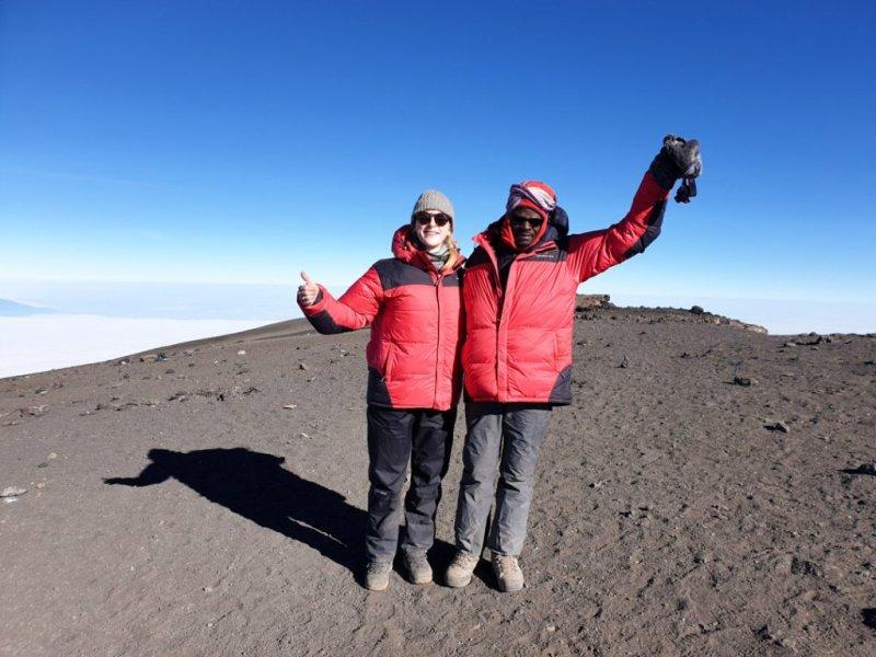 Trekkers on the summit of Mt Kilimanjaro