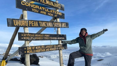 Happy climber at Uhuru sign
