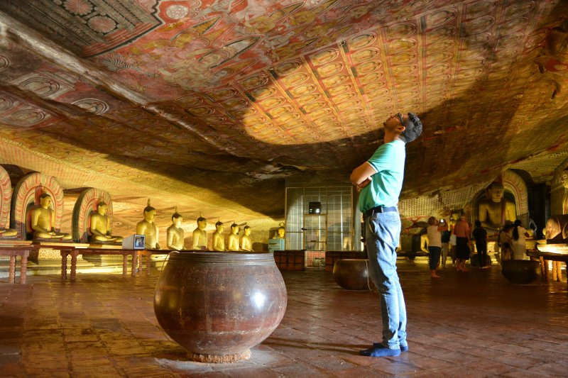 Admire centuries old paintings in the Dambulla Rock Caves