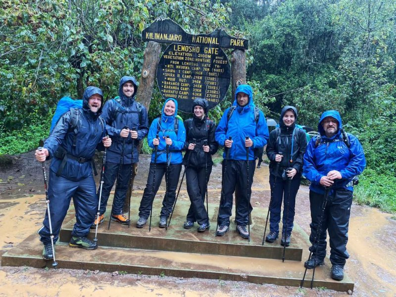 Lemosho Gate Kilimanjaro group photo rain