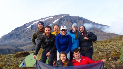 Kilimanjaro group with Follow Alice flag