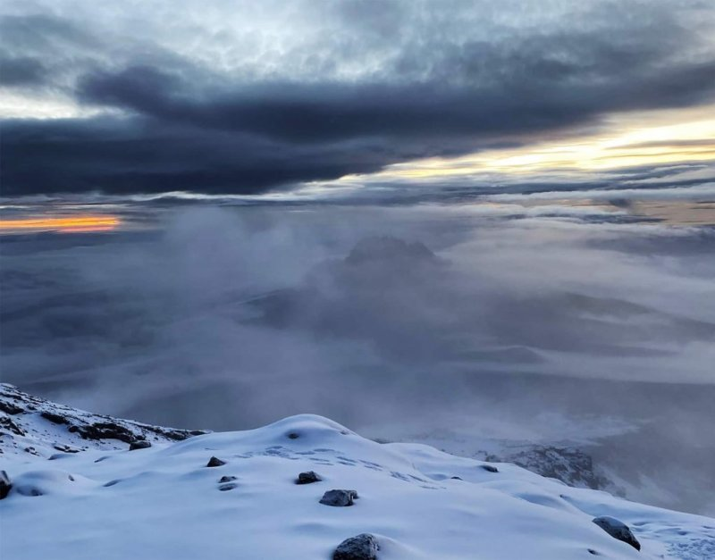 Clouds View from Kilimanjaro Summit with snow