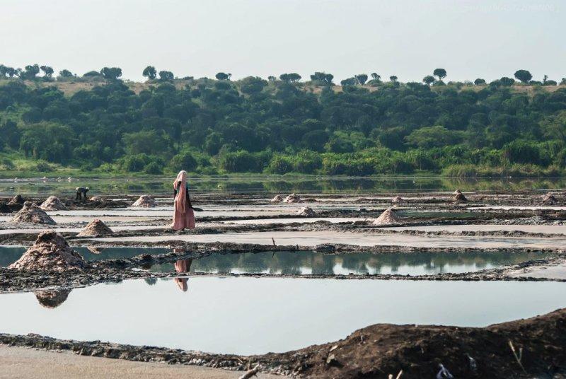 A local woman walks among the salt ponds of Lake Katwe in Uganda   Top 20 things to do in Uganda