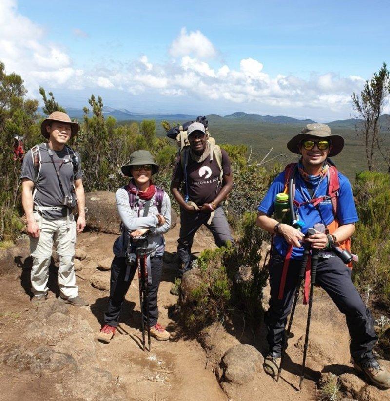 Kilimanjaro smiling trekkers moorland, train for Kilimanjaro