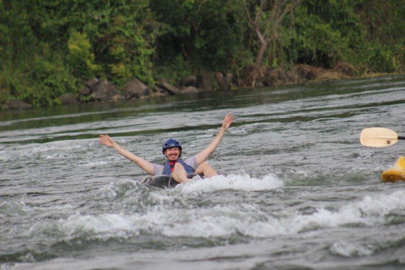 man tubing on River Nile in Uganda