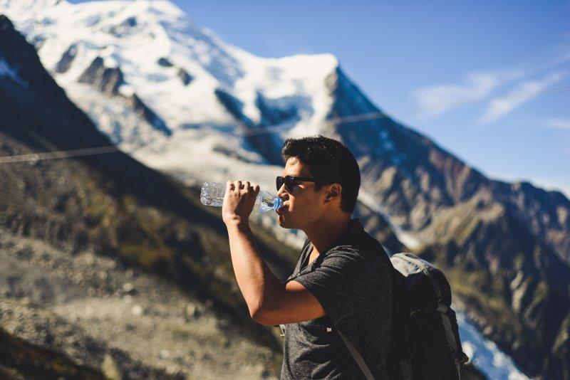 Male hiker drinking from water bottle