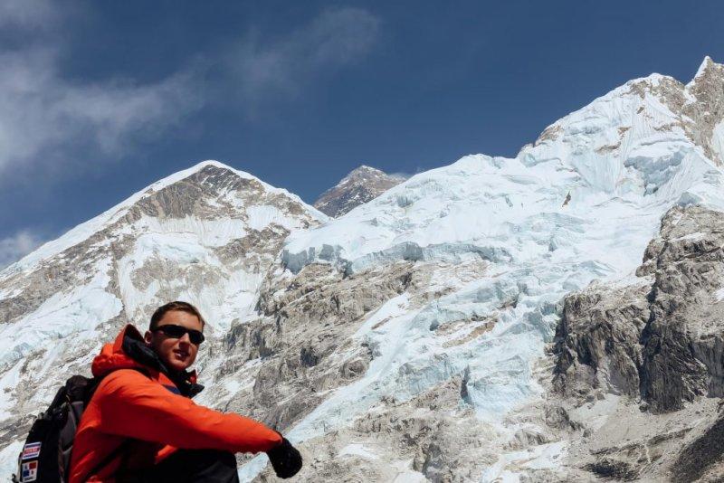 Trekker with backpack wearing sunglasses