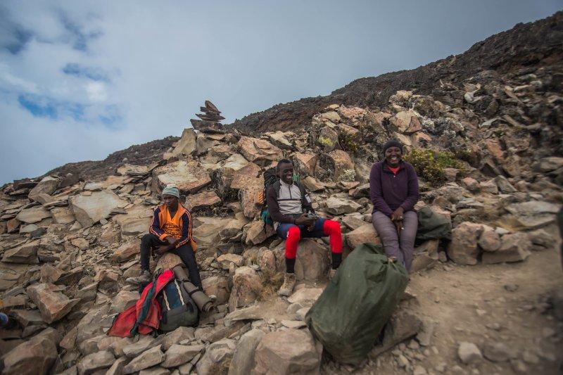 Porters on Kilimanjaro taking a break