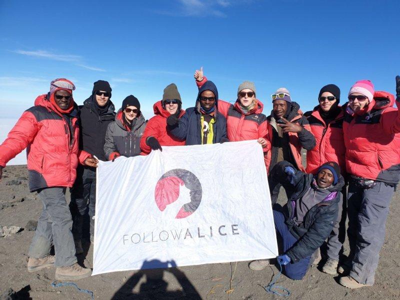 Follow Alice summit team photo Kilimanjaro