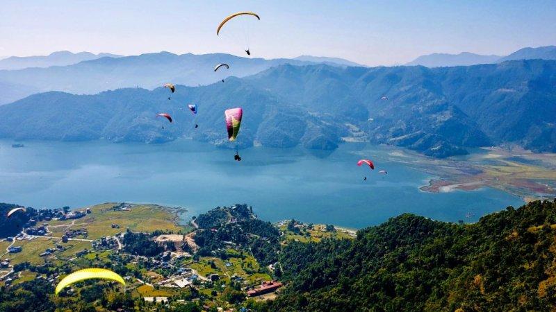 Paragliders over Phewa Lake and Pokhara, Nepal, Annapurna Circuit route