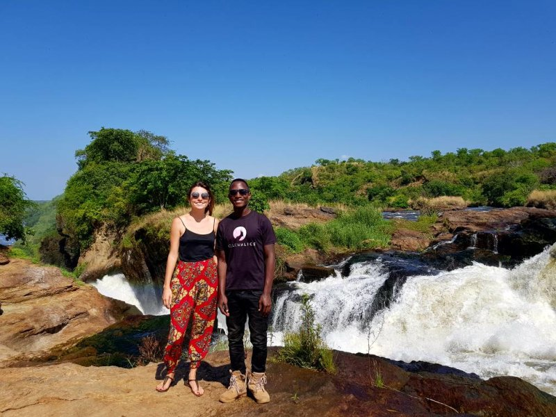 Man and woman standing in front of Murchison Falls in Uganda
