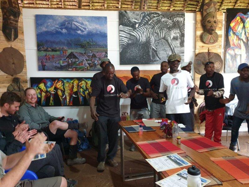 Indoor Follow Alice Kilimanjaro tipping ceremony