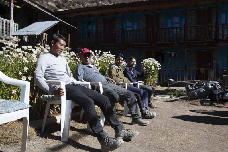 Men relaxing at a tea lodge on the Annapurna Circuit