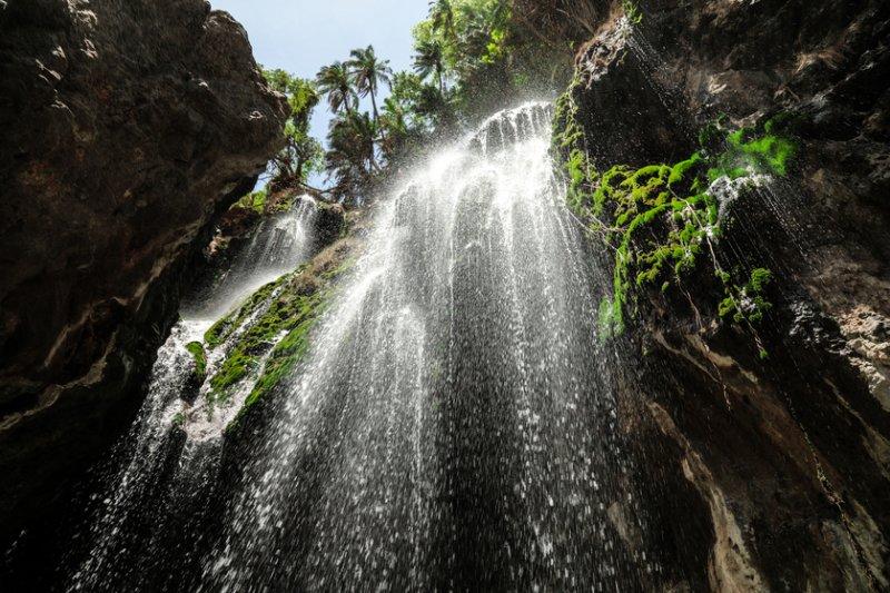 lookin gup at Ngero Sera Waterfall