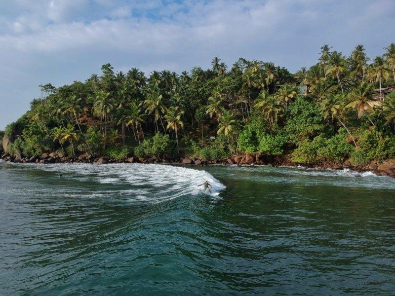 Sri Lanka beach and surfer on adventure holiday