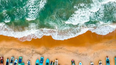 Aerial view of small boats on Sri Lankan beach