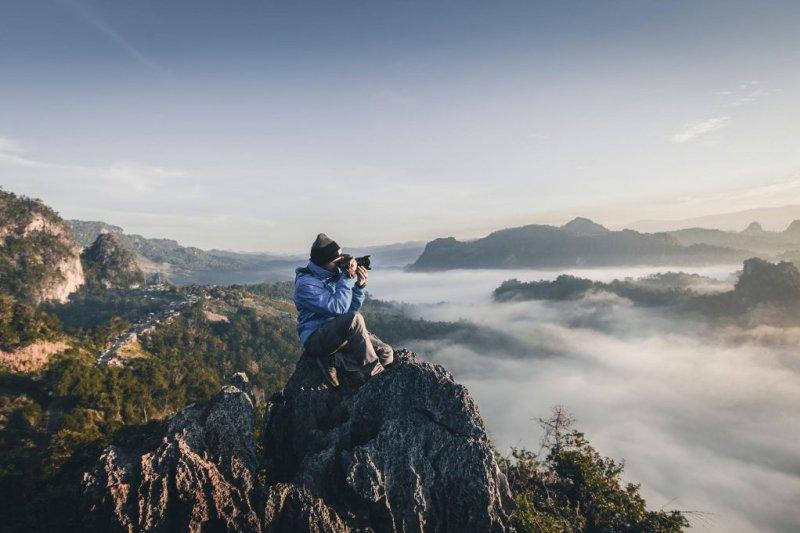 Man on trek taking photo
