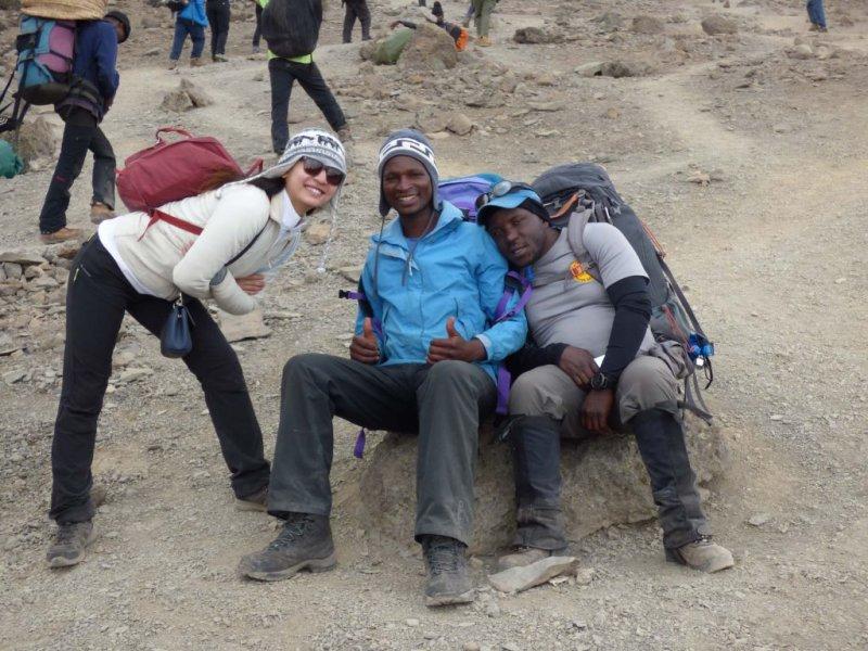 Kilimanjaro trekkers smiling and resting