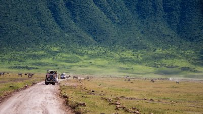 Safari vehicle on game drive in Ngorongoro Crater