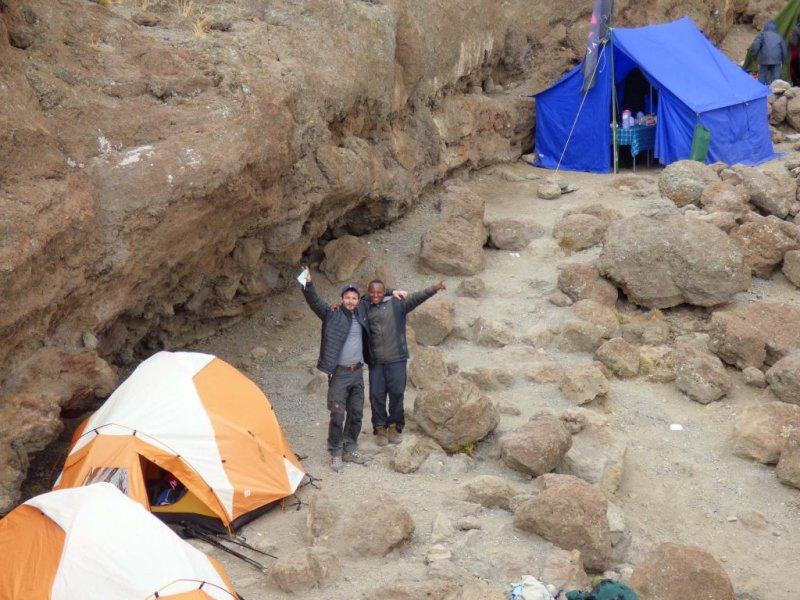 Tents and happy trekkers on Kilimanjaro