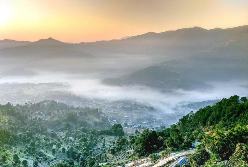 beautiful valley settlement in mist in Nepal