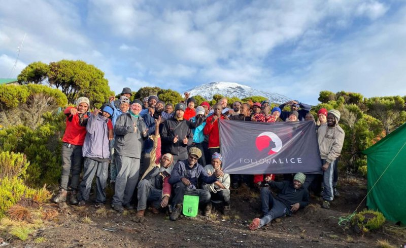 Group Picture Kilimanjaro Team Holding Flag
