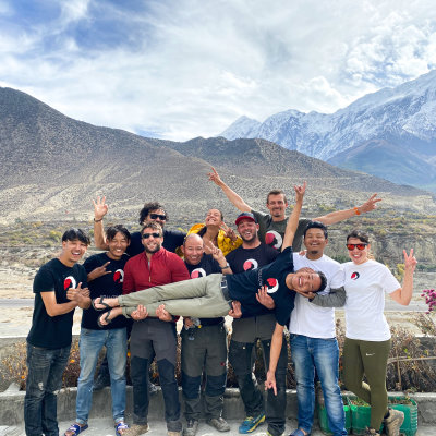 Nepal team with logo and mountains in the background